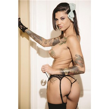 Tatooed female topless in black stockings