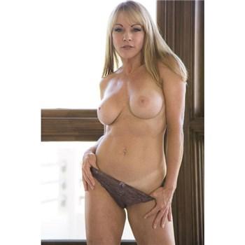 Blonde female topless in panties
